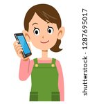 a housewife wearing an apron is ...   Shutterstock .eps vector #1287695017