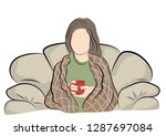 woman sitting wrapped in a... | Shutterstock .eps vector #1287697084