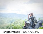 travelers trekking backpacks on ... | Shutterstock . vector #1287723547