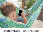 kid using smart phone in... | Shutterstock . vector #1287763531