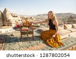 a beautiful young woman sits on ... | Shutterstock . vector #1287802054