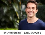 good looking guy smiling to... | Shutterstock . vector #1287809251