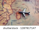 airplane miniature aiming to... | Shutterstock . vector #1287817147