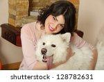Stock photo girl and dog 128782631