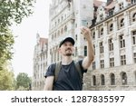 a young man or tourist or... | Shutterstock . vector #1287835597