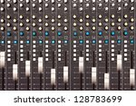Moving faders on a mixing desk - motion blur - stock photo