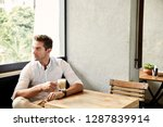 thoughtful guy in cafe looking... | Shutterstock . vector #1287839914