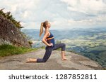Young Woman Stretching In...