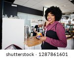 curly hair african american... | Shutterstock . vector #1287861601