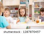 little children have a lunch in ...   Shutterstock . vector #1287870457