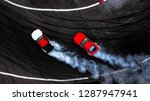 Small photo of Two car drifting battle on asphalt street road race track with smoke, Aerial view automobile and automotive modify tuning car competition battle with black tire skid mark texture and background.