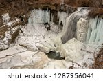 flowing waterfall partially... | Shutterstock . vector #1287956041