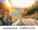 mountain biker ride down from... | Shutterstock . vector #1288011154