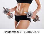 slim woman with dumbbells ... | Shutterstock . vector #128802271