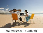 Casual workers having a business meeting at the beach - stock photo