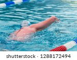 man swimming in a pool with... | Shutterstock . vector #1288172494