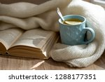 reading a book with cup of hot... | Shutterstock . vector #1288177351