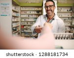 male apothecary taking... | Shutterstock . vector #1288181734