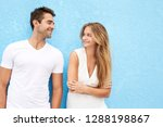 smiling couple in white against ... | Shutterstock . vector #1288198867