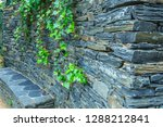 stone wall with a metal grid... | Shutterstock . vector #1288212841