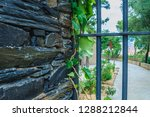 stone wall with a metal grid... | Shutterstock . vector #1288212844