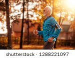 senior runner doing stretching... | Shutterstock . vector #1288221097
