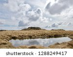 reflections of clouds in a... | Shutterstock . vector #1288249417