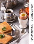 a soft boiled egg  croutons and ... | Shutterstock . vector #1288298404