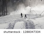 a family skiing  | Shutterstock . vector #1288347334