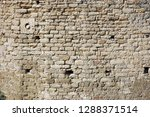 old stone wall built of ... | Shutterstock . vector #1288371514