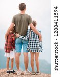 back view of father and kids...   Shutterstock . vector #1288411594
