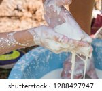 closeup of hands holding... | Shutterstock . vector #1288427947