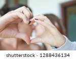 heart from the hands of young... | Shutterstock . vector #1288436134