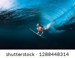 surfer woman dive underwater... | Shutterstock . vector #1288448314