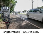 Small photo of Mobile police radar for traffic speed control. Police radar installed near the road to control the speed limit. Police radar on the road