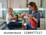 young mother holds her little... | Shutterstock . vector #1288477117