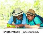 two children watching the map... | Shutterstock . vector #1288501837