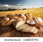 bread and oil on the wooden...   Shutterstock . vector #128855791