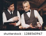 two experienced sommeliers... | Shutterstock . vector #1288560967