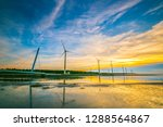 Small photo of In the coastal areas of Taichung, Asia, Taiwan, the tides are different day and night, and the strong sea breeze here, so many windmills are built here. At dusk, when the sea is ebb, the beautiful sun