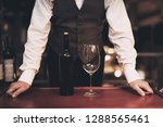 waiter stands before tray with... | Shutterstock . vector #1288565461