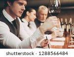 confident handsome sommelier... | Shutterstock . vector #1288566484