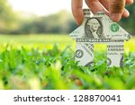 hand holding banknote house... | Shutterstock . vector #128870041