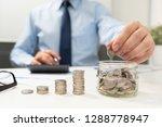 man calculates the savings.... | Shutterstock . vector #1288778947