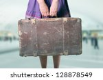 woman with luggage at the... | Shutterstock . vector #128878549