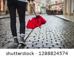 woman holding red umbrella and... | Shutterstock . vector #1288824574