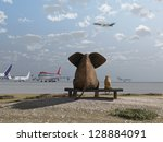 Elephant And Dog Sitting At Th...
