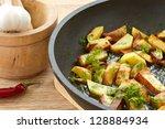 potatoes fried in oil in a... | Shutterstock . vector #128884934
