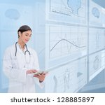 woman doctor using a tablet pc... | Shutterstock . vector #128885897