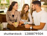 a group of friends talking and... | Shutterstock . vector #1288879504